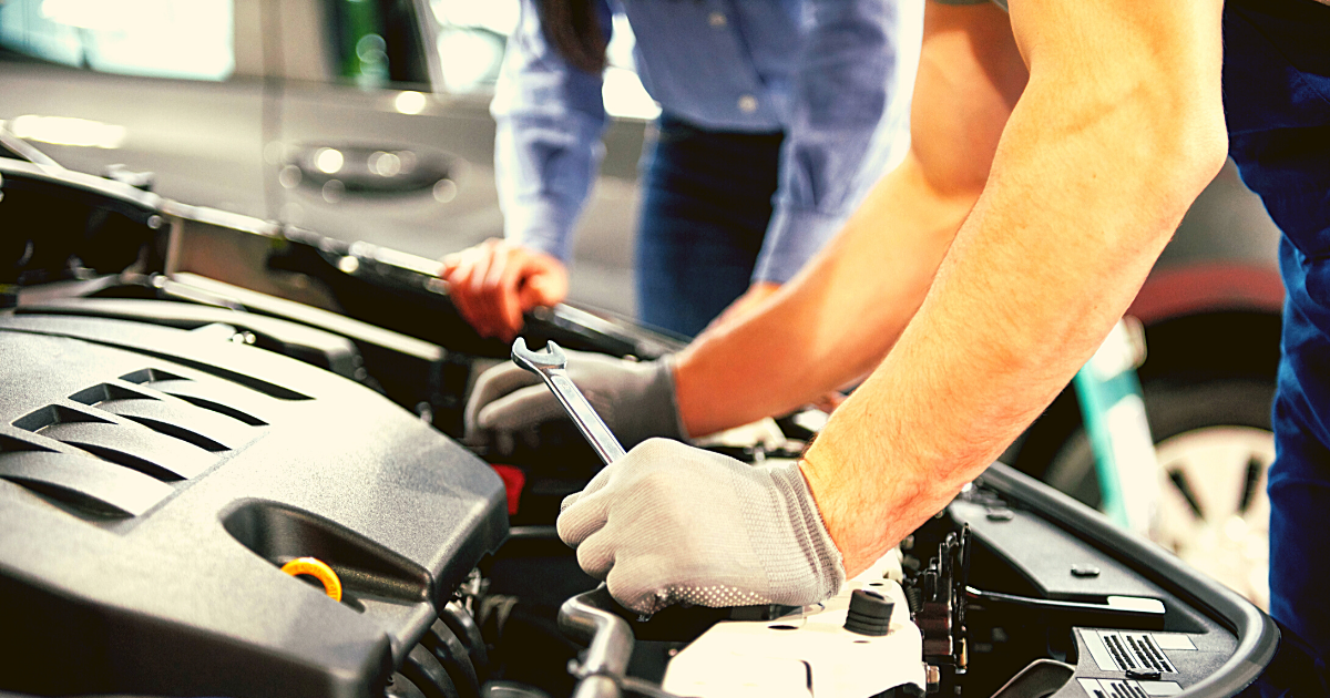 mechanic working on a car with a wrench