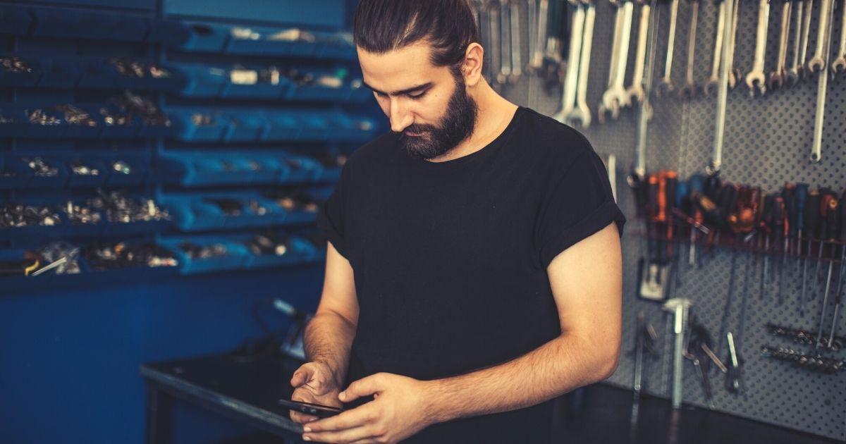 technician on mobile phone